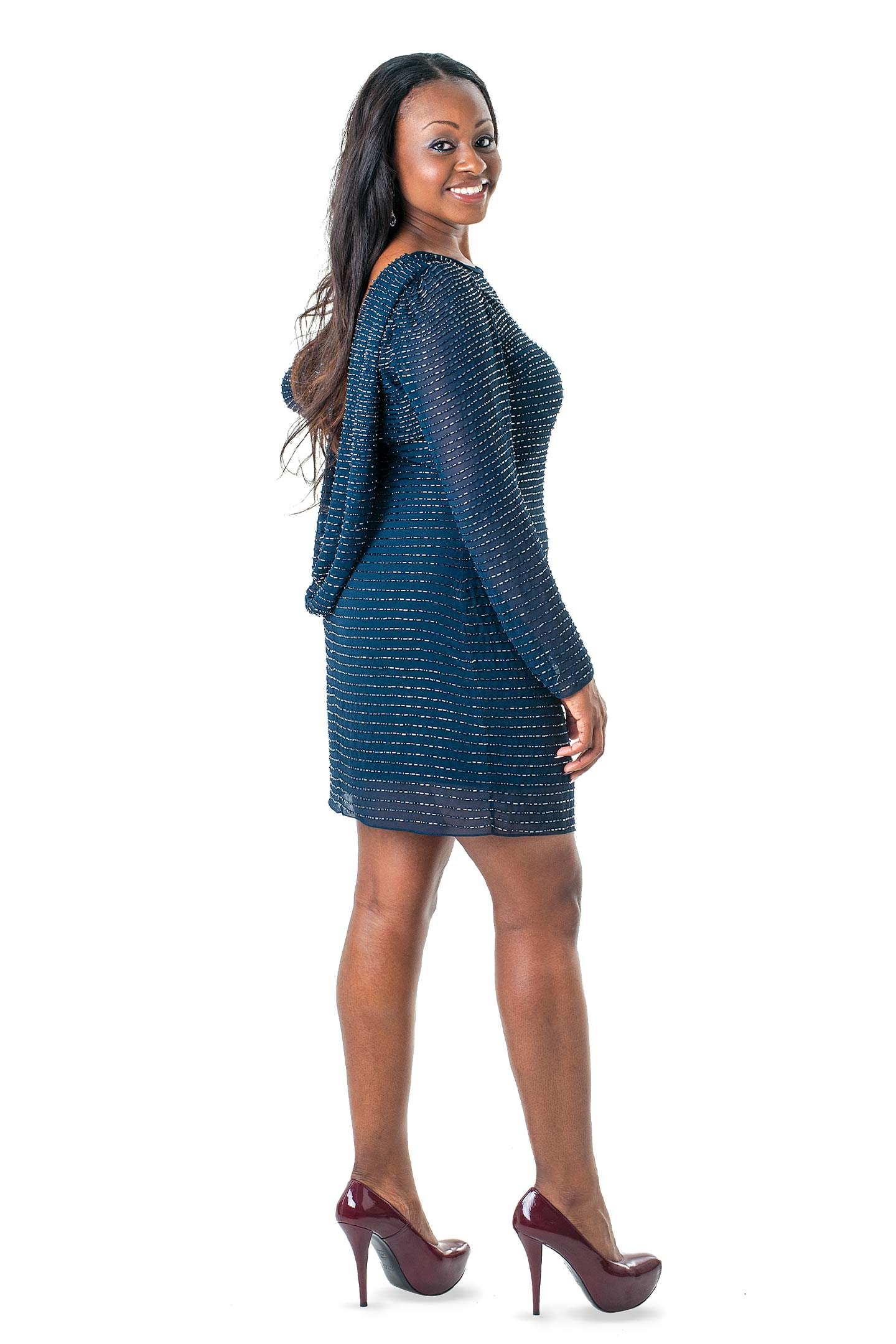 Brittany Johnson Mills models holiday fashion from boutique couture